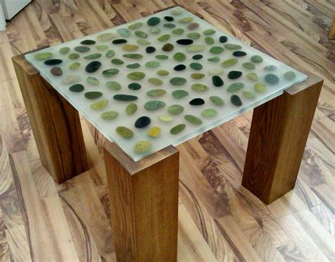 resin table top with embedded river rocks by fogliart