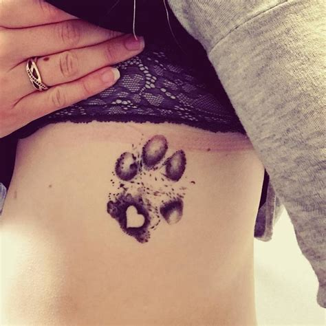 dog house tattoo people are quot branding quot themselves with dog paw tattoos
