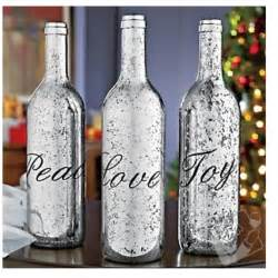 silver wine bottles silver spray paint on wine bottles repurposed bottles mercury glass empty