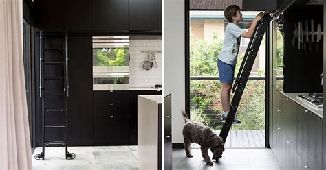 Kitchen With A Ladder This Kitchen Has A Rolling Ladder To Reach The