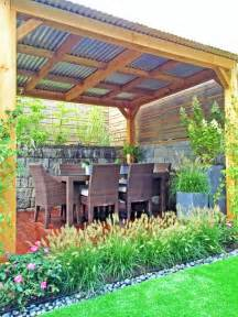 Tin Roof Pergola by Brooklyn Townhouse Backyard Cedar Pergola Fence