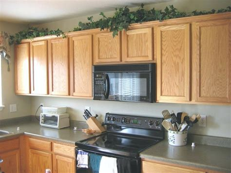 should you decorate above kitchen cabinets what to do with space above kitchen cabinets how to