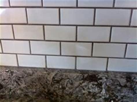 sanded or unsanded grout for kitchen backsplash white subway herringbone tile counter led lights
