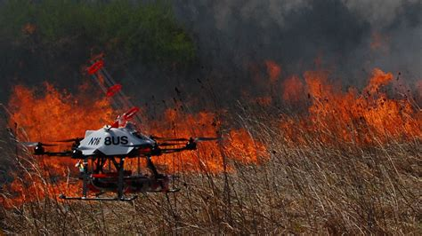 fire fighting drone drones that launch flaming balls are being tested to help