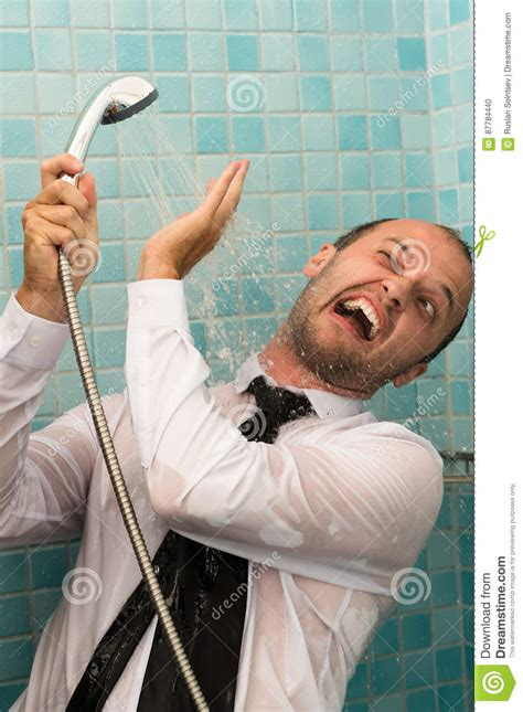 men in the bathroom crazy business man fighting with shower in bathroom stock