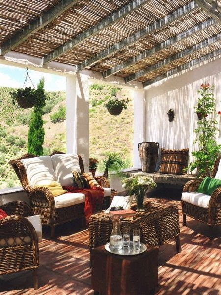 terrace  slanted beam roof wicker furniture curtains