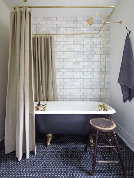 Pedestal Bathtub by Black Hex Bathroom Tile Through The Front Door