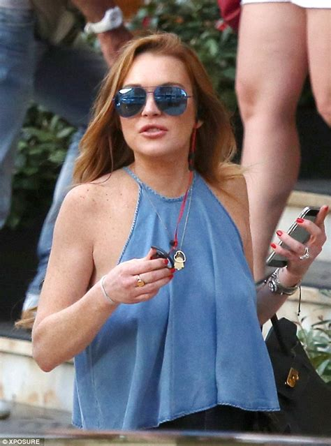 lindsay lohan braless in halter neck top for lunch date in