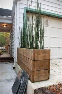 horsetail reed recycled wood planter landscaping