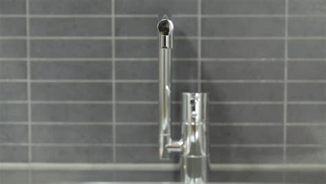 Field Faucet by Up With Shallow Depth Of Field Of A Running Faucet