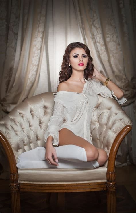sit your y ass on that couch beautiful young woman in white sitting on sofa posing