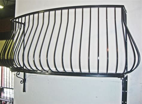 Wrought iron Balconies. Pot belly wrought iron balcony
