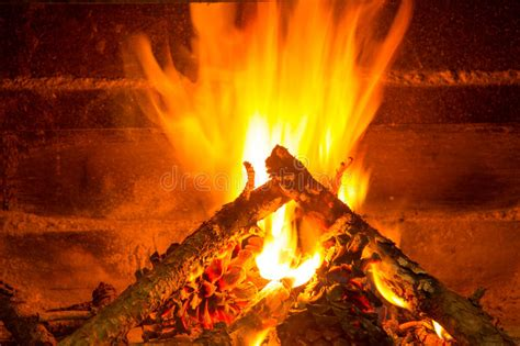 Burning Pine In Fireplace by Burning Firewood In Chimney With Pine Cones Stock Image