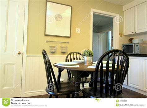 kitchen  white cabinets   table  chairs