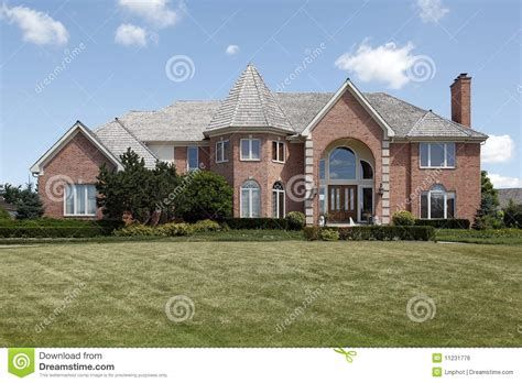 Custom Home Plans And Prices large brick home with turret stock photo image of