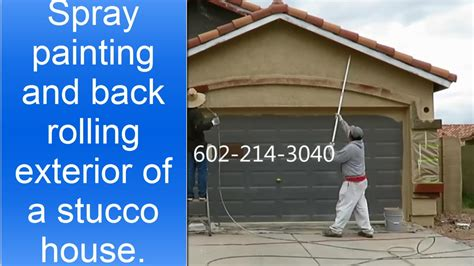 painting my house spray painting and back rolling exterior of a stucco house