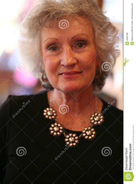 elegant mature woman wearing silver jewelry stock photo elegant mature woman wearing a silver necklace royalty