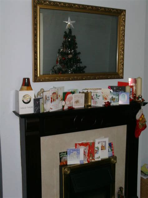 christmas cards mantelpiece fire decorations holidays