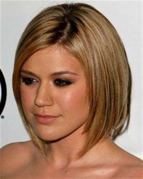 hipster bob ear length bob with a dominant fringe and ear piercings on pinterest piercing ear piercings and