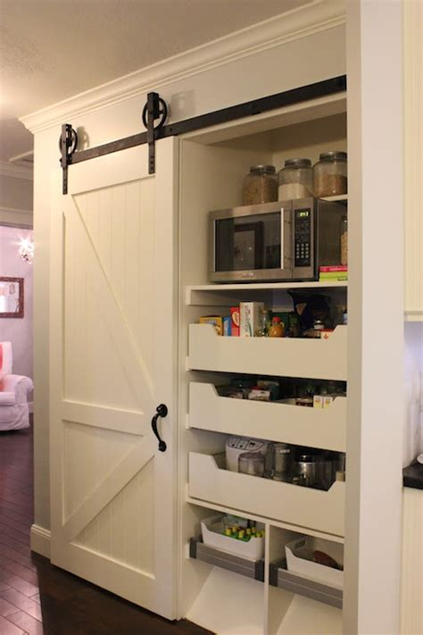 kitchen pantry with sliding barn door traditional