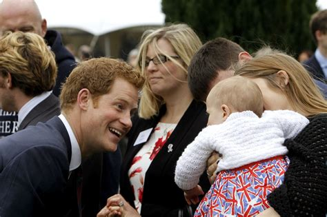 see prince george with uncle harry en route to the queens princes william and harry visit tedworth house to