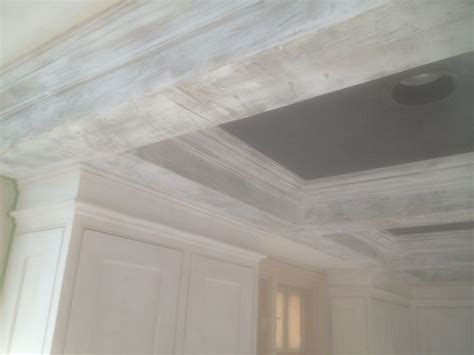 black venetian plaster ceiling with white distressed beams