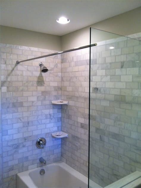 this tub shower benefits from a glass splash panel as well