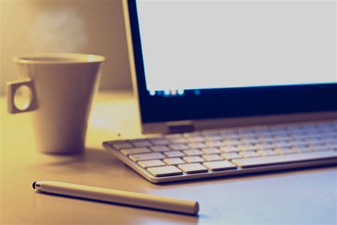 on computer blur up cup of coffee on computer desk