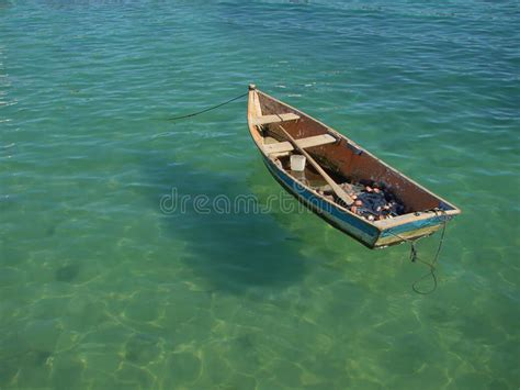floating boat photo row boat floating on the water royalty free stock