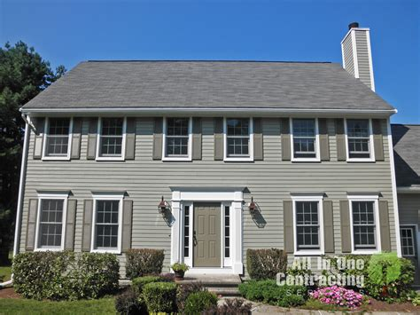 monterey taupe colorplus hardiplank with arctic white trim and darker taupe shutters carron