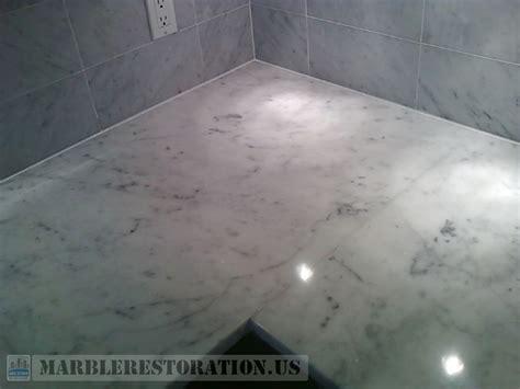 tiled back splash re caulking on kitchen countertop