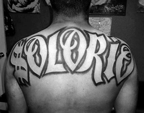 tattoo lettering upper back 50 last name tattoos for men honorable ink ideas