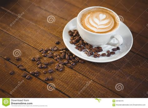 Cappucino Coffee Bean cup of cappuccino with coffee and coffee beans stock
