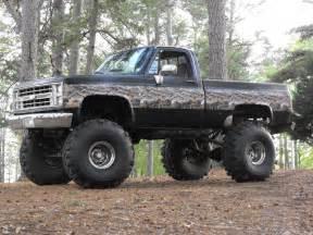 camo and black trucks