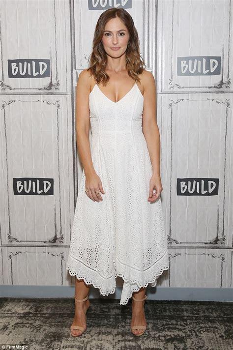 Minka White Slip On minka flaunts fantastic cleavage in angelic dress
