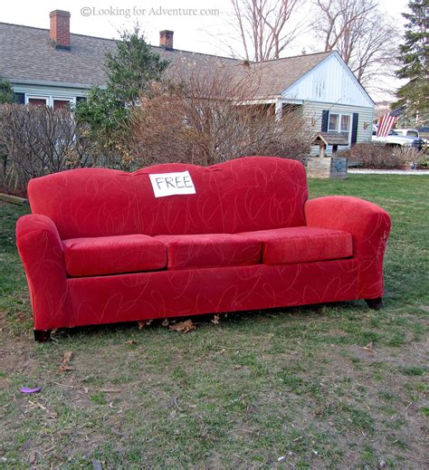 on the couch pictures roadside red couch sofa outside on the front lawn of a