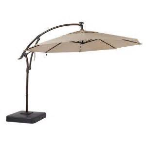 Hton Bay Patio Umbrella Base Hton Bay 11 Ft Led Offset Patio Umbrella In Sunbrella Sand Yjaf052 A The Home Depot
