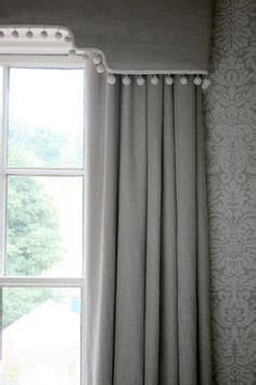 box window blinds curtains with pelmet with a beaded trim window