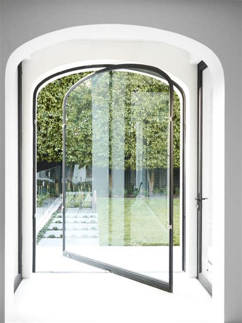 Pivot Glass Door Arched Pivot Glass Door Design Decorating Ideas Doors Glass Doors And Pivot Doors