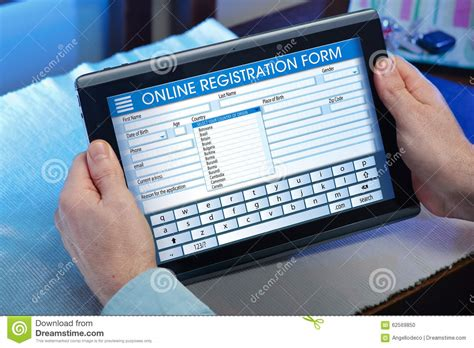 Online Survey Application - man at home looking at blank online survey form on digital table stock photo image