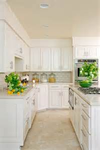 White Kitchen Cabinets Beige Countertop Before And After Photostyling My Kitchen Tobi Fairley