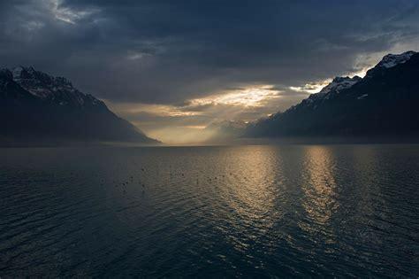 landscape nature lake mountain mist sun rays winter