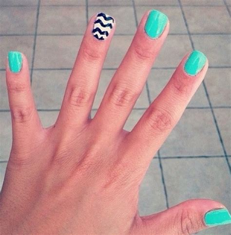 zig zag pattern nails aqua nails with a black and white zig zag accent nail