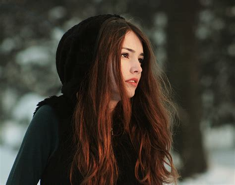 girl with brown hair in snow girl pretty face winter snow