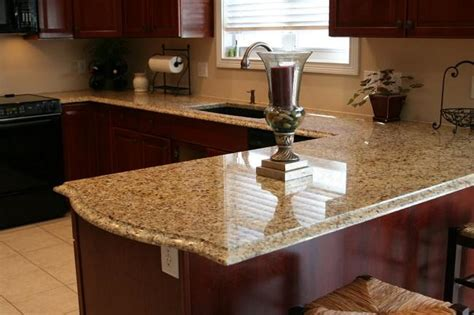 Pictures Of New Venetian Gold Granite Countertops by New Venetian Gold And Subway Tile