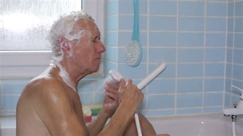 the bathtub guy senior man washing his body with bath brush stock footage
