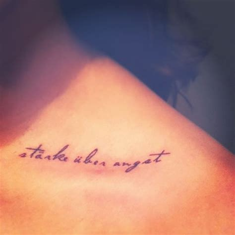 tattoo quotes about strength and faith quot strength over fear quot in german my family s language on
