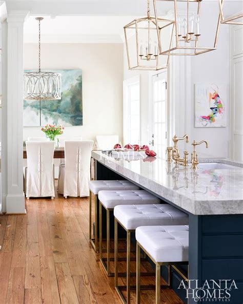dark blue kitchen island  gold barstools