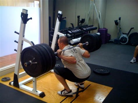 top squat bar dangerous to use barbell squat without padding physical