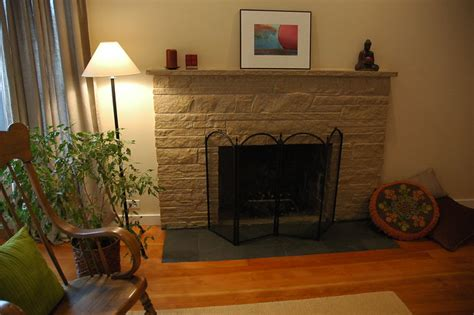 zen style painted stone fireplace makeover  flat